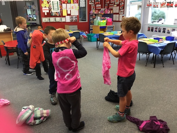Putting on our pink shirts