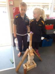 8. Tom and Emily recreating the Eiffel Tower using blocks